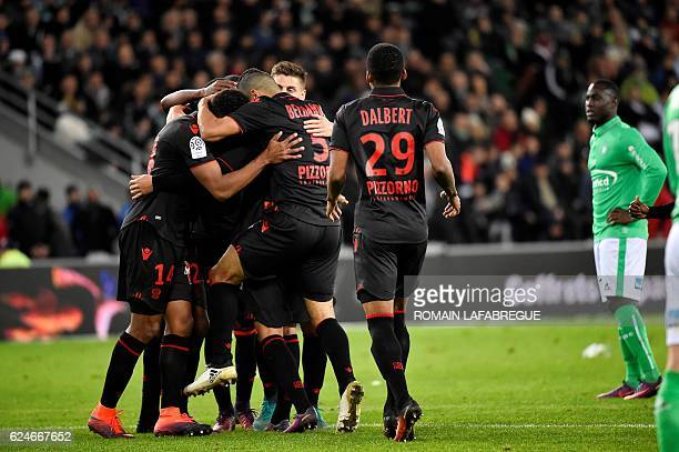 Nice's players celebrate after scoring a goal during the French L1 football match between SaintEtienne and Nice at the GeoffroyGuichard stadium in...