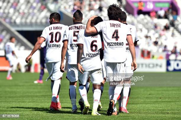 Nice's players celebrate after scoring a goal during the French L1 football match Toulouse vs Nice on April 23 2017 at the Municipal Stadium in...