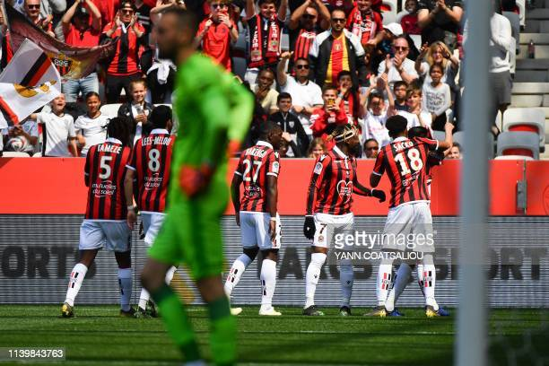 Nice's players celebrate after scoring during the French L1 football match between OGC Nice and En Avant Guingamp at the Allianz Riviera stadium in...