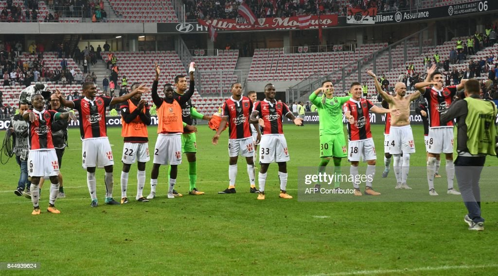 Nice's players celebrate after winning during the French L1 football match between Nice (OGCN) and Monaco (ASM) on September 9, 2017 at the Allianz Riviera stadium in Nice, southeastern France. /