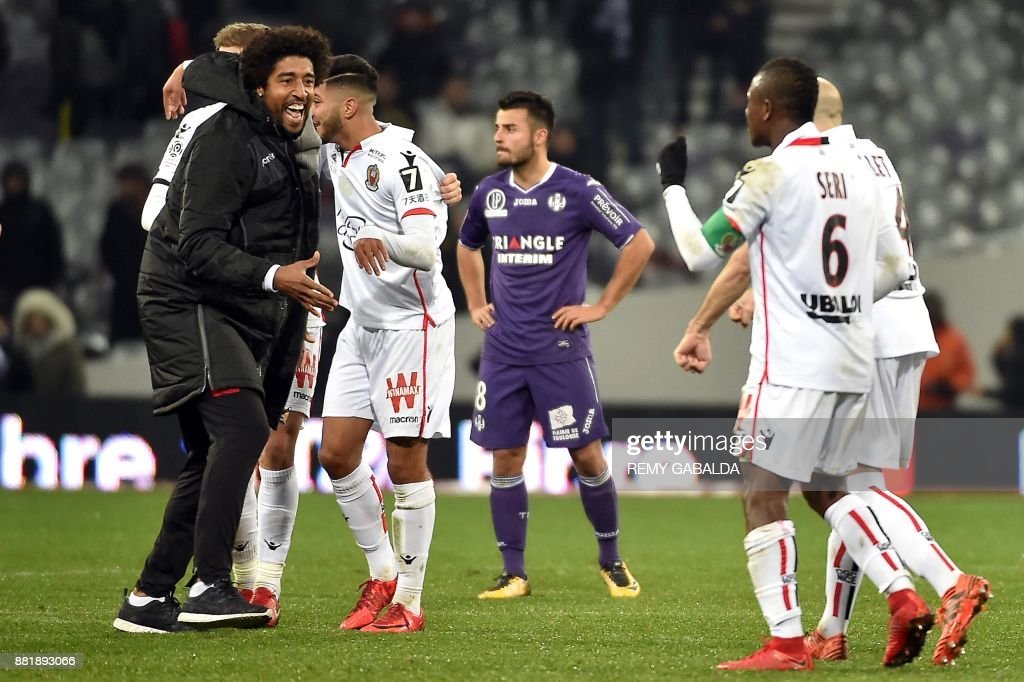 Nice's players celebrate at the end of the French L1 football match Toulouse vs Nice,on November 29, 2017 at the Municipal Stadium in Toulouse, southern France. /