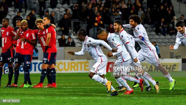 Nice's players react after winning the French League Cup round of 16 football match between Lille vs Nice on December 13 2017 at the Pierre Mauroy...