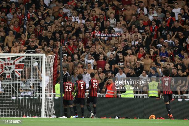 Nice's players speak with supporters as the referee halted the game following homophobic songs and banners during the French L1 football match...