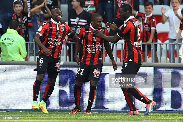 Nice's Portuguese defender Ricardo Pereira celebrates after scoring a goal with team mates Ivorian midfielder Jean Michael Seri and Italian forward...