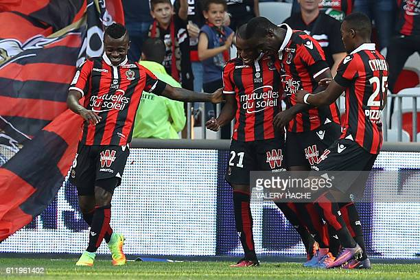 Nice's Portuguese defender Ricardo Pereira celebrates after scoring a goal with teammates during a French L1 football match between Nice and Lorient...