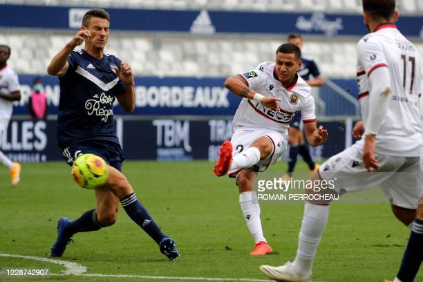 Nice's Portuguese midfielder Rony Lopes shoots during the French L1 football match between Bordeaux and Nice on September 27, 2020 at Matmut...