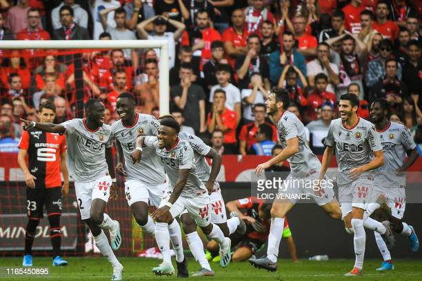 Nice's Senegalese defender Racine Coly celebrates after scoring a goal during the French L1 football match between Stade Rennais and Nice, on...