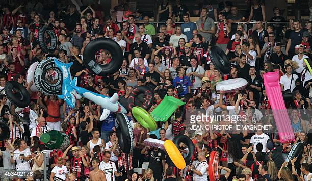 Nice's supporters cheer prior the French L1 football match Nice against Toulouse on August 9 2014 at the Allianz Riviera stadium in Nice southeastern...