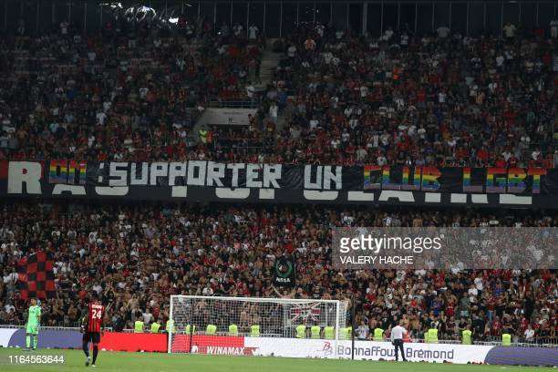 """Nice's supporters display a banner reading """"OM: support an LGBT team to fight against homophobia"""" during the French L1 football match between OGC..."""