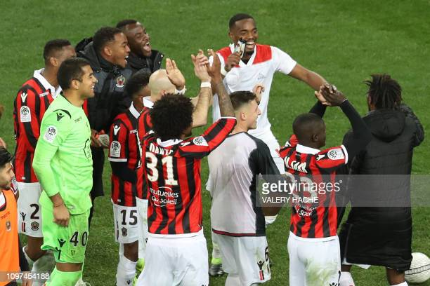 Nice's team players celebrate after winning at the end of the French L1 football match between OGC Nice and Olympique Lyonnais at the Allianz Riviera...
