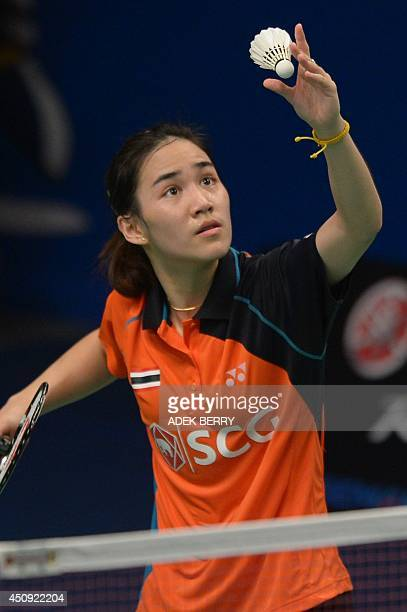 Nichaon Jindapon of Thailand plays a shuttle cock against Bae Yeon Ju of South Korea at the 2014 Badminton Indonesia Open women singles quarter final...