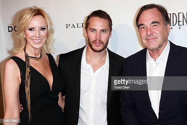 Niche Media Group Publisher Alison Miller Taylor Kitsch and Director Oliver Stone pose at the Los Angeles Confidential Magazine Celebrates Their...