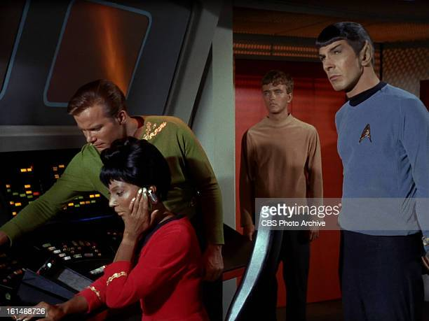 Nichelle Nichols as Lieutenant Uhura William Shatner as Captain James T Kirk Robert Walker Jr as Charlie Evans and Leonard Nimoy as Mr Spock in in...