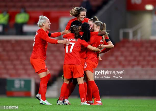 Nichelle Prince of Canada celebrates with Jessie Fleming, Janine Beckie and teammates after scoring their team's second goal during the International...