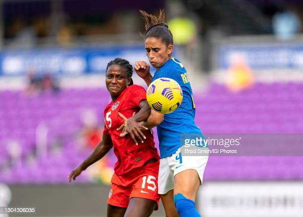 Nichelle Prince of Canada fights for the ball with Rafaelle of Brazil during a game between Brazil and Canada at Exploria Stadium on February 24,...