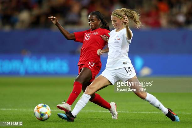 Nichelle Prince of Canada is challenged by Katie Bowen of New Zealand during the 2019 FIFA Women's World Cup France group E match between Canada and...