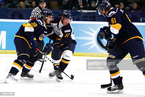 Nichlas Torp and Jonas Johansson of Espoo Blues fights for the puck during the IIHF Champions Hockey League match between HV 71 Joenkoeping and Espoo...