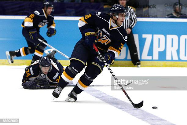 Nichlas Torp runs with the puck during the IIHF Champions Hockey League match between HV 71 Joenkoeping and Espoo Blues on December 3, 2008 in...