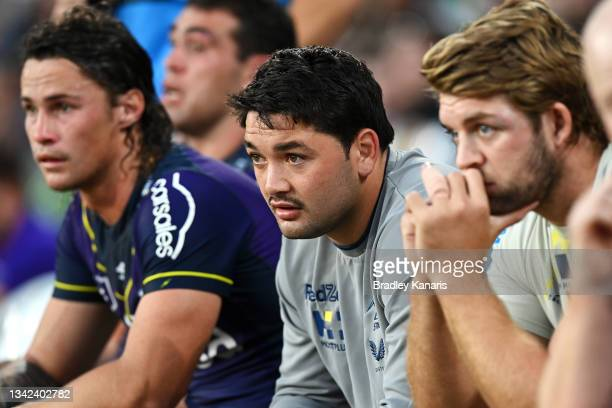 Nicho Hynes, Brandon Smith and Christian Welch of the Storm watch on from the bench during the NRL Preliminary Final match between the Melbourne...