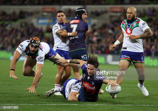 Nicho Hynes of the Storm scores a try during the round seven NRL match between the Melbourne Storm and the New Zealand Warriors at AAMI Park, on...