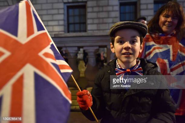 Nicholas age eight with Union Jack bow tie and flag during the Leave Means Leave Brexit day celebration party outside the Houses of Parliament at...