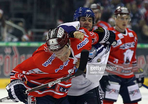 Nicholas Angell of Berlin fights with Charles Cook of Hamburg during the DEL Bundesliga match between EHC Eisbaeren Berlin and Hamburg Freezers at O2...