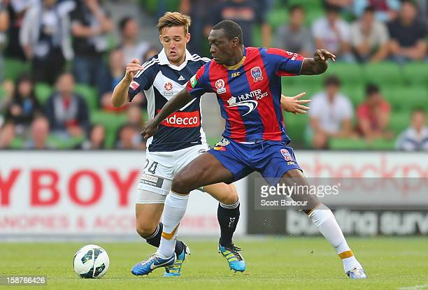 Nicholas Ansell of the Victory and Emile Heskey of the Jets compete for the ball during the round 13 ALeague match between the Melbourne Victory and...