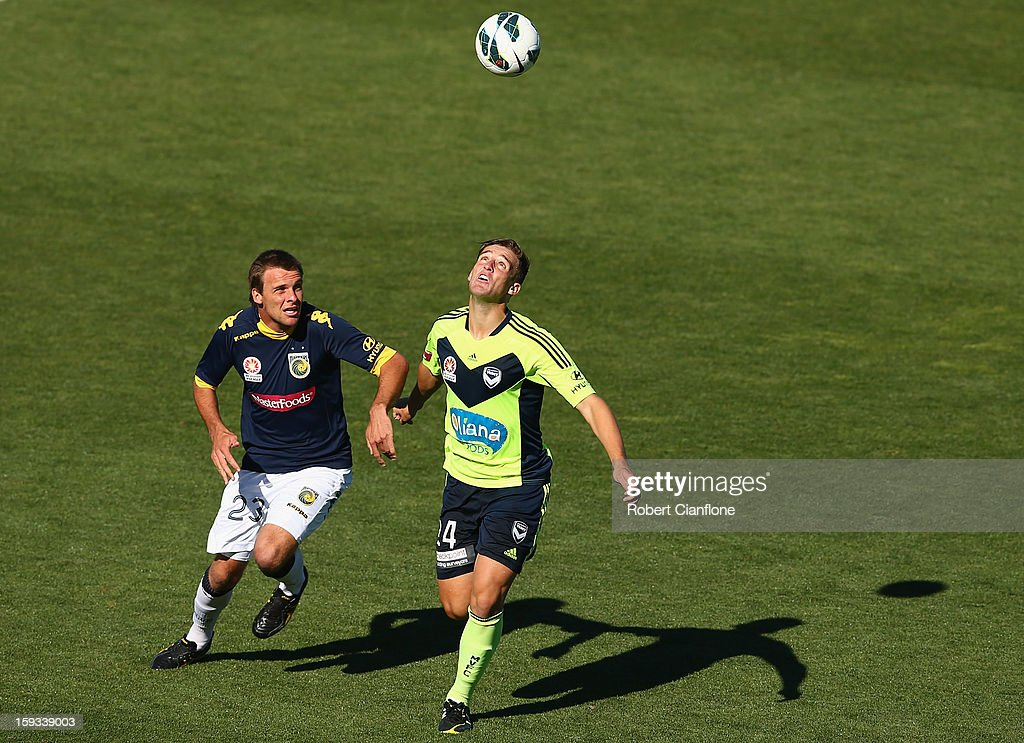 Nicholas Ansell of the Victory is challenged by Adam Kwasnik of the Mariners during the round 16 A-League match between the Melbourne Victory and the Central Coast Mariners at Aurora Stadium on January 12, 2013 in Launceston, Australia.