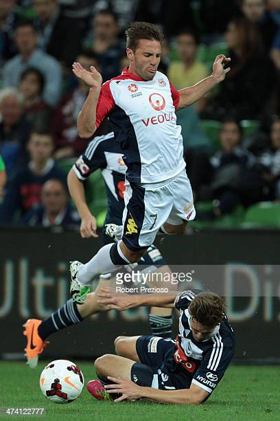 Nicholas Ansell of Victory and Jeronimo Neumann of Adelaide collide during the round 20 ALeague match between Melbourne Victory and Adelaide United...