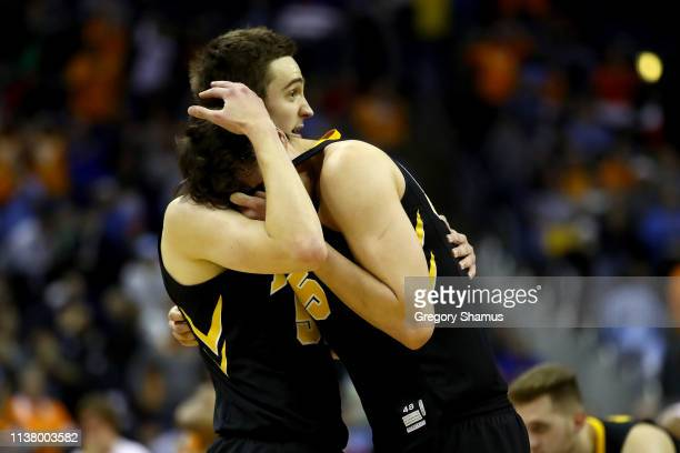 Nicholas Baer and Luka Garza of the Iowa Hawkeyes react after being defeated 8377 by the Tennessee Volunteers in the Second Round of the NCAA...