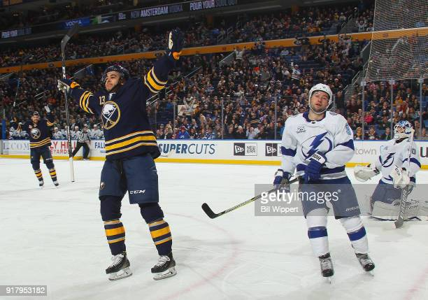 Nicholas Baptiste of the Buffalo Sabres celebrates his first period goal against Louis Domingue of the Tampa Bay Lightning as Tyler Johnson of the...