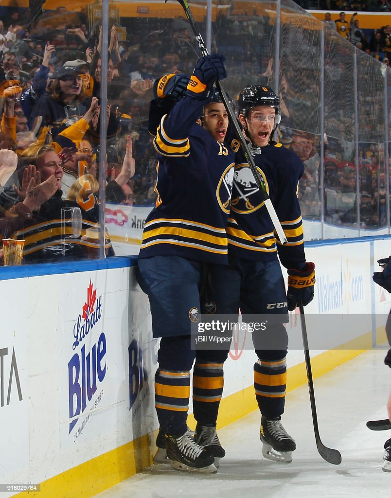 Nicholas Baptiste #13 of the Buffalo Sabres celebrates his first period goal against the Tampa Bay Lightning with Casey Nelson #8 during an NHL game on February 13, 2018 at KeyBank Center in Buffalo, New York.