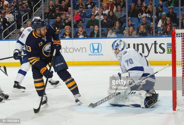 Nicholas Baptiste of the Buffalo Sabres scores a first period goal against Louis Domingue of the Tampa Bay Lightning during an NHL game on February...