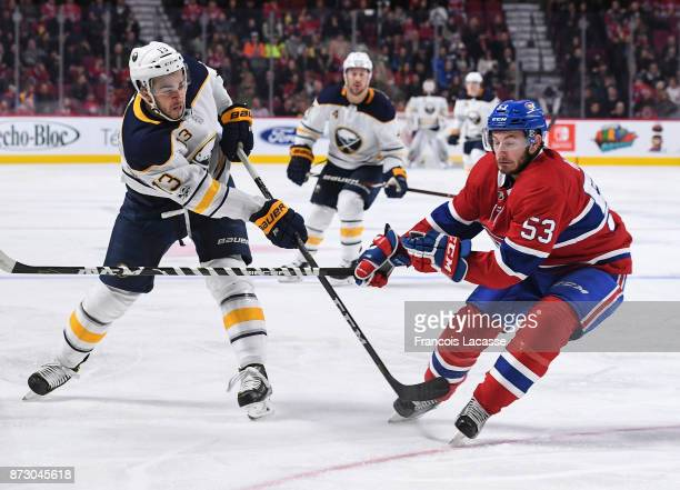 Nicholas Baptiste of the Buffalo Sabres shots under pressure of Victor Mete of the Montreal Canadiens in the NHL game at the Bell Centre on November...