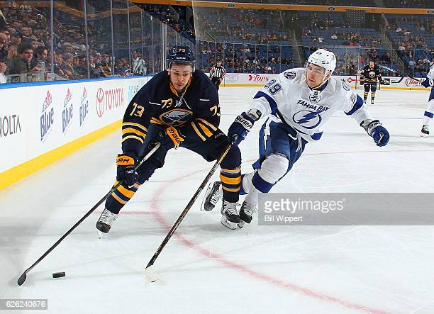 Nicholas Baptiste of the Buffalo Sabres skates against Nikita Nesterov of the Tampa Bay Lightning during an NHL game at the KeyBank Center on...