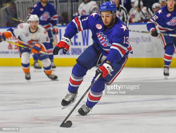 Nicholas Baptiste of the Rochester Americans carries the puck up ice during a game against the Bridgeport Sound Tigers at the Webster Bank Arena on...