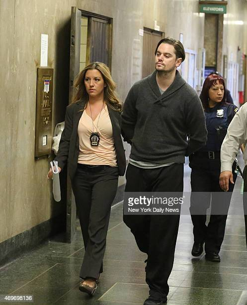 Nicholas Brooks is led into Manhattan Criminal Court on Monday May 6 2013 Brooks already in jail awaiting trial for allegedly killing swimsuit...