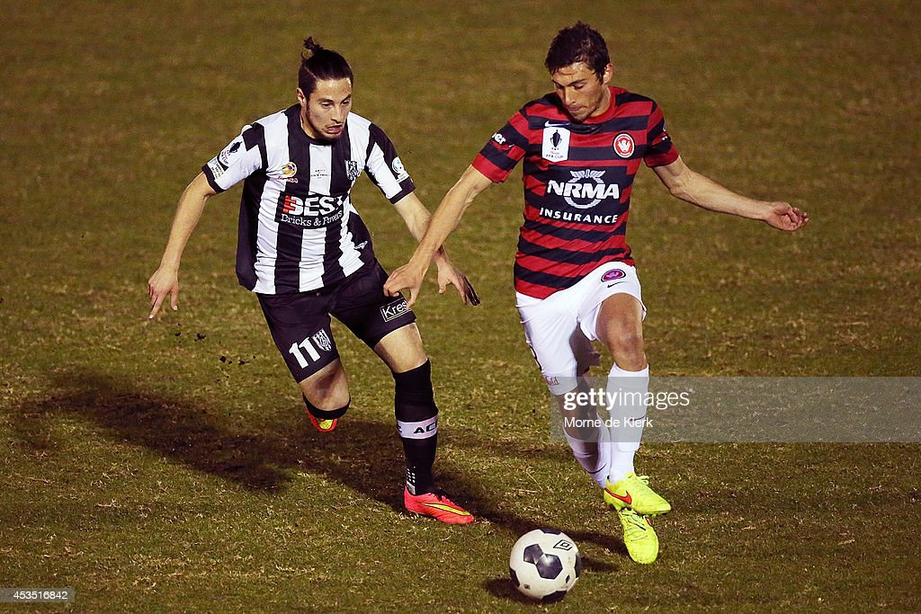 Nicholas Bucco of Adelaide City competes with Mateo Poljak of Western Sydney during the FFA Cup match between Adelaide City and Western Sydney Wanderers at Marden Sports Complex on August 12, 2014 in Adelaide, Australia.