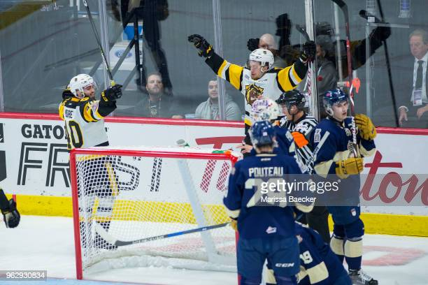 Nicholas Caamano and Ryan Moore of Hamilton Bulldogs celebrate a goal against the Regina Pats at Brandt Centre Evraz Place on May 18 2018 in Regina...