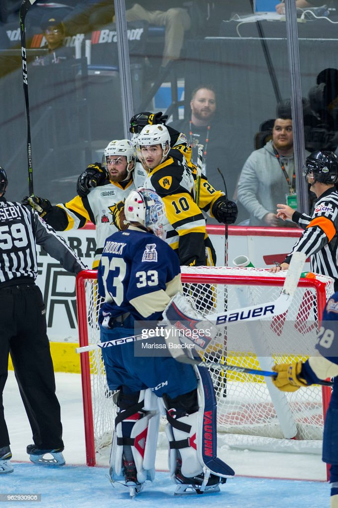 Nicholas Caamano #10 and Ryan Moore #40 of Hamilton Bulldogs celebrate a goal against the Regina Pats at Brandt Centre - Evraz Place on May 18, 2018 in Regina, Canada.