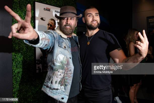 Nicholas Cage and Weston Coppola Cage attend the premiere of Quiver Distribution's 'Running with the Devil' at Writers Guild Theater on September 16,...