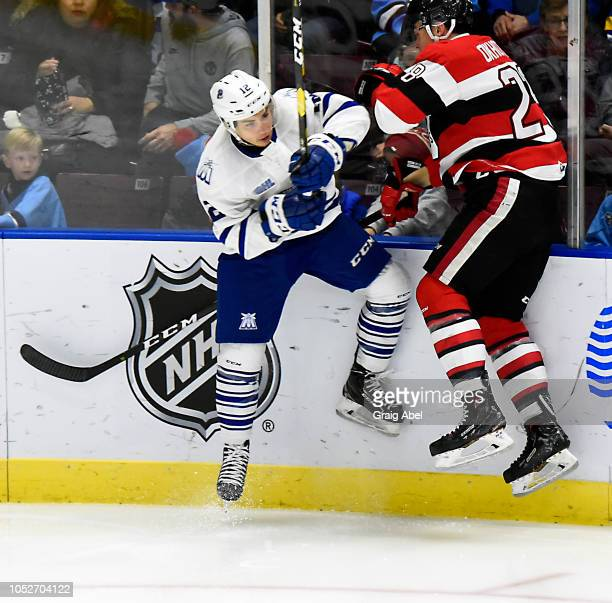 Nicholas Canade of the Mississauga Steelheads checks Nikita Okhotyuk of the Ottawa 67s during OHL game action on October 21, 2018 at Paramount Fine...