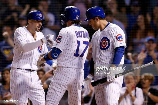 Nicholas Castellanos Kris Bryant and Anthony Rizzo of the Chicago Cubs celebrate after Bryant hit a home run in the eighth inning against the San...