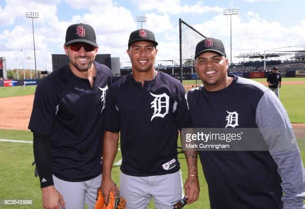 Nicholas Castellanos Leonys Martin and Brayan Pena of the Detroit Tigers pose for a photo while wearing special SD logo baseball hats to honor the...