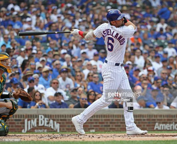 Nicholas Castellanos of the Chicago Cubs bats against the Oakland Athletics at Wrigley Field on August 07 2019 in Chicago Illinois