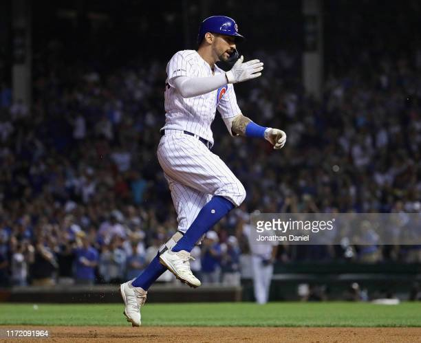 Nicholas Castellanos of the Chicago Cubs celebrates as he runs the bases after hitting a three run home run in the 5th inning against the Seattle...