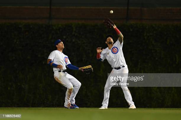 Nicholas Castellanos of the Chicago Cubs fields a fly ball as teammate Albert Almora Jr #5 backs up the play during the ninth inning against the...