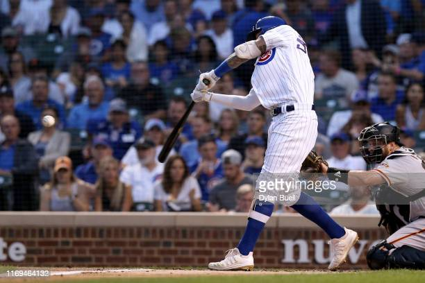 Nicholas Castellanos of the Chicago Cubs hits a home run in the first inning against the San Francisco Giants at Wrigley Field on August 21 2019 in...