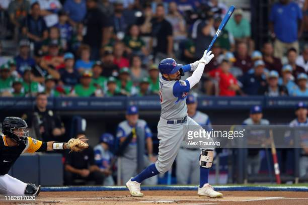 Nicholas Castellanos of the Chicago Cubs hits a solo home run in the first inning during the 2019 Little League Classic between the Chicago Cubs and...