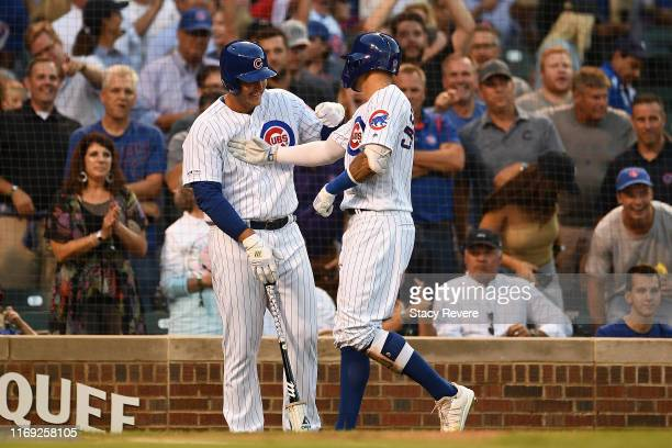 Nicholas Castellanos of the Chicago Cubs is congratulated by Anthony Rizzo following a home run against the San Francisco Giants during the first...